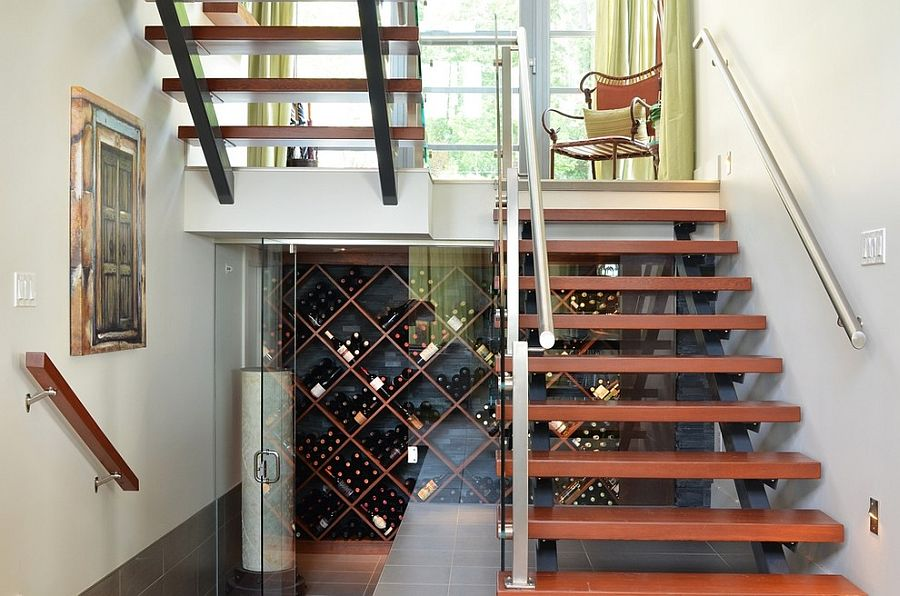 Awesome contemporary wine cellar under the sleek staircase [From: Wakefield Construction / First Impressions Photography]