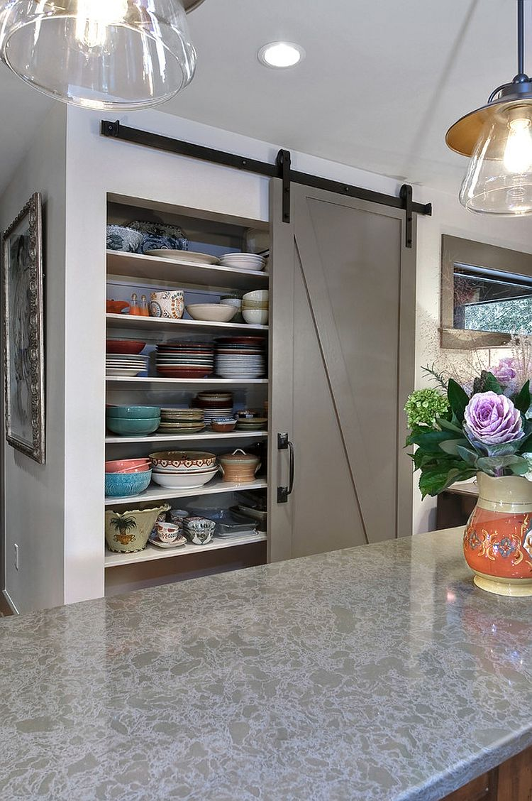 Barn door pantry offers plenty of storage space for chinaware