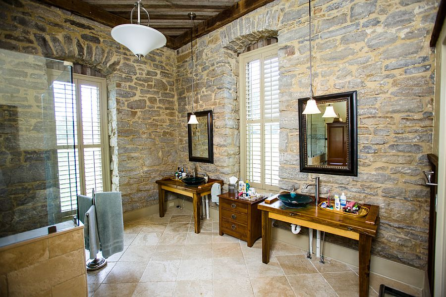 Bathroom inside 1800s Bourbon Distillery turned into a unique modern home [Design: Wilmes & Associates Architects]