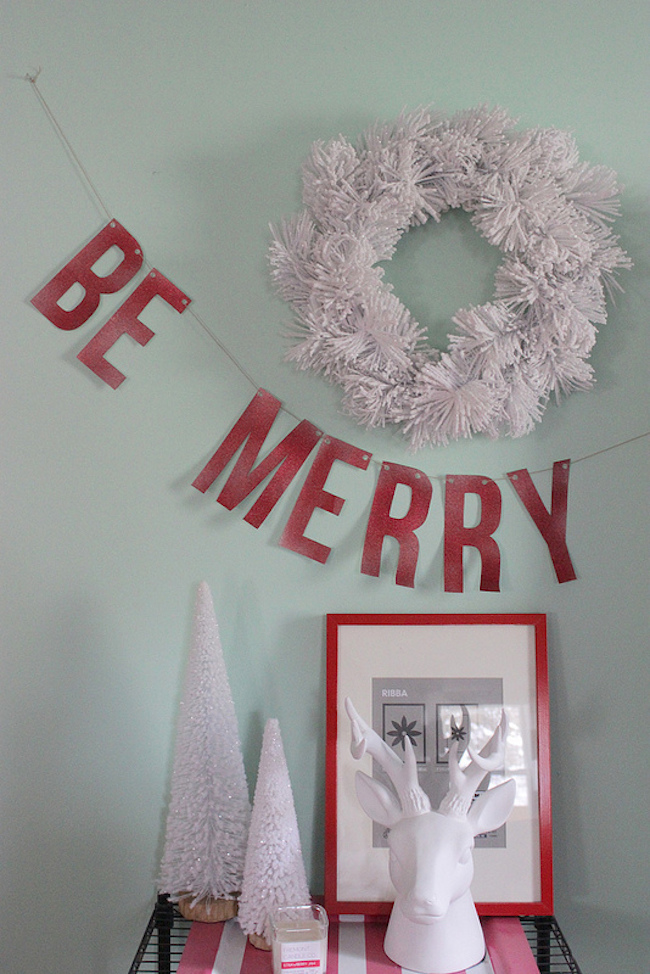 Be Merry holiday banner on the wall