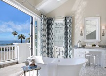 Beach style bathroom flows into the private balcony on one side and master bedroom on the other