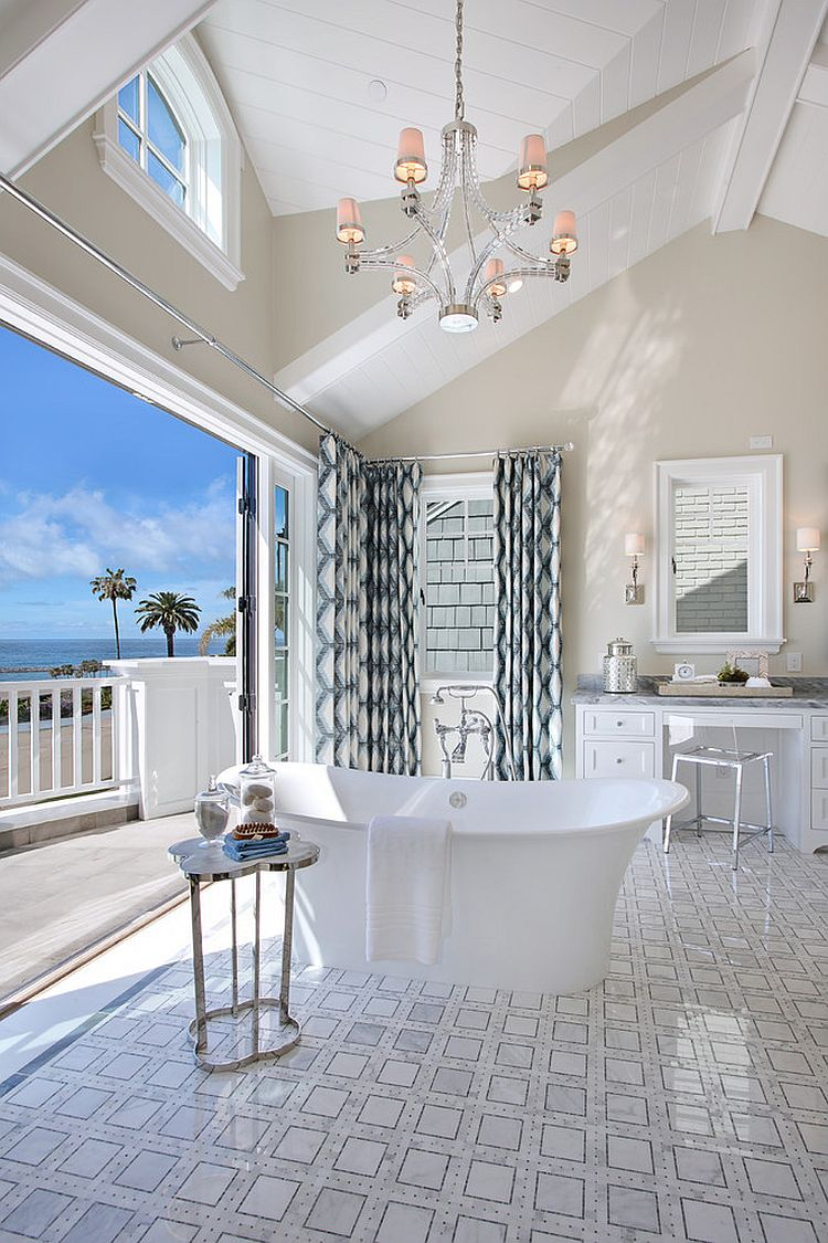 Beach style bathroom flows into the private balcony on one side and master bedroom on the other [Design: Spinnaker Development]