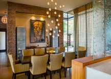 Beautiful Bocci lighting fixture enlivens the modern dining room