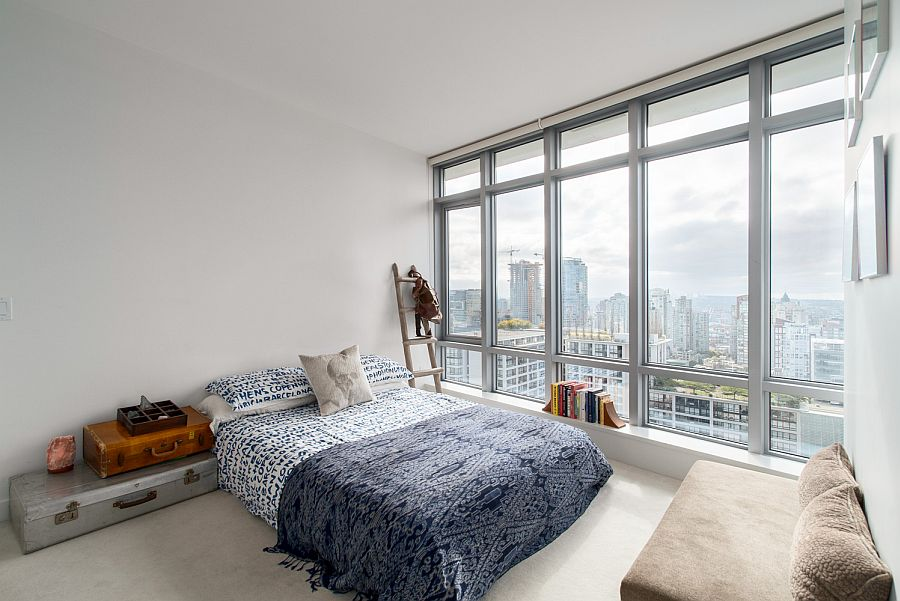 Beautiful and breezy bedroom with captivating view of the city skyline