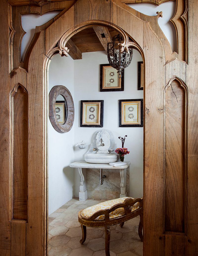 Beautiful powder room with custom fittings and mirror that captures the Mediterranean style perfectly