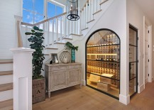 Beautiful temperature controlled wine room under the stairs