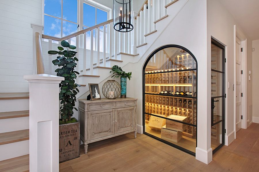 Beautiful temperature controlled wine room under the stairs [Design: Brandon Architects]