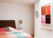 Bedding and artwork add pastel hues to the contemporary bedroom