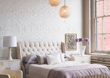 Bedding, lighting, rug and subtle details give this bedroom an air of femininity