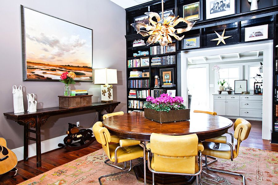 Black bookshelves separate the eclectic dining