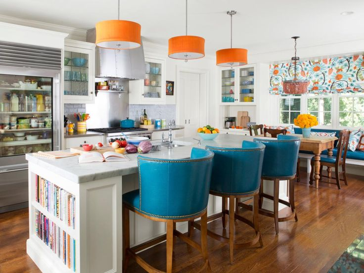 Blue bar stools with curved backs paired with pops of orange