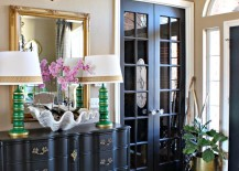 Bold-and-eclectic-entryway-with-a-gold-framed-mirror-and-antler-decor-above-it-217x155