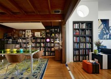 Bookshelves act as a common design element in the living room and dining room