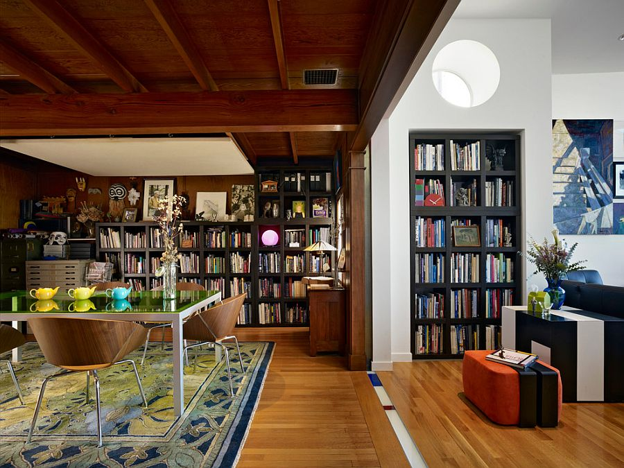 Bookshelves Act As A Common Design Element In The Living Room And Dining
