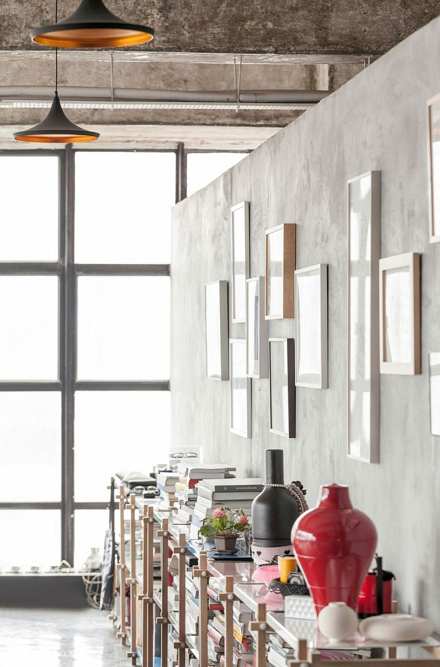 Bookshelves provide both storage space and a decorative option in the industrial loft
