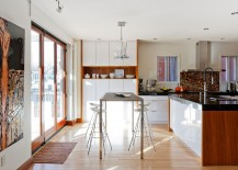 Breezy breakfast zone next to the kitchen siland with metallic bar stools