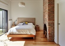 Brick fireplace brings traditional charm to the contemporary bedroom [Design: Andrew Maynard Architects]