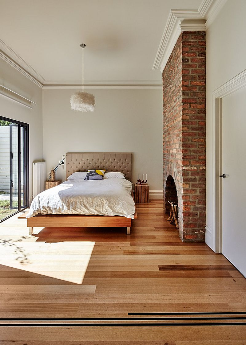 Brick fireplace brings traditional charm to the contemporary bedroom design andrew maynard architects