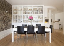 Brick-wall-brings-brilliant-textural-contrast-to-the-refined-dining-room-with-bookshelves-217x155