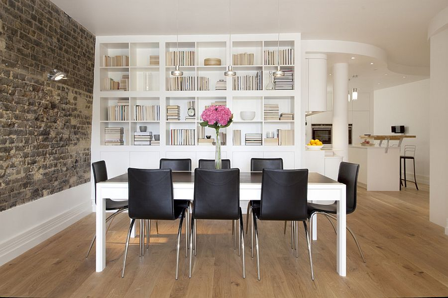 Brick Wall Brings Brilliant Textural Contrast To The Refined Dining Room With Bookshelves From