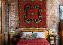 Bright-and-beautiful-Tibetan-rug-on-the-wall-of-the-eclectic-bedroom-in-New-York-home-217x155