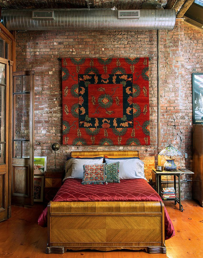 Bright and beautiful Tibetan rug on the wall of the eclectic bedroom in New York home