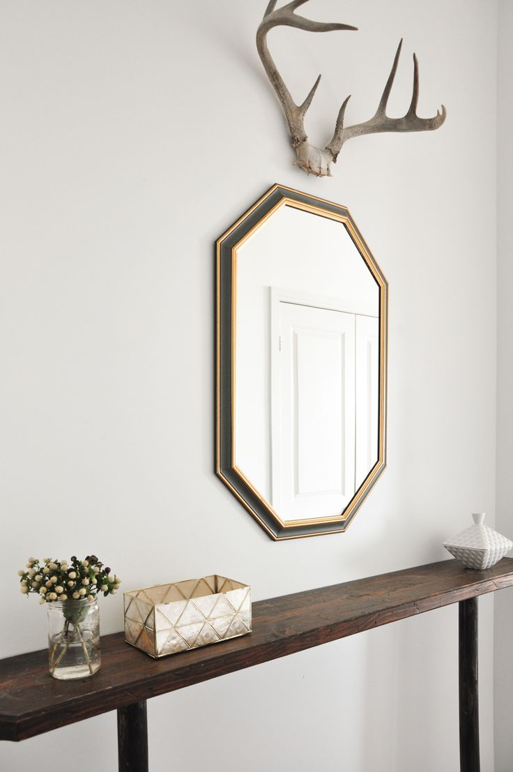 Bright and minimal entryway with beautiful mirror and decorative antlers