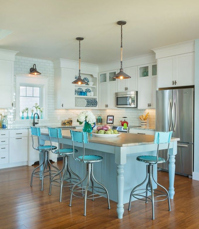 Bright blue bar stools that go with the kitchen island