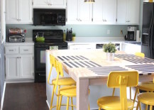 Bright yellow bar stools in a kitchen with small touches of green 217x155 18 Brilliant Kitchen Bar Stools That Add a Serious Pop of Color