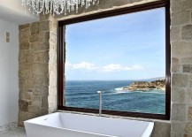 Brilliant antique stone and marble bathroom showcases modern Mediterranean style