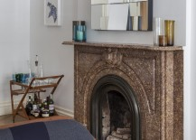 Brown marble fireplace in an eclectic space