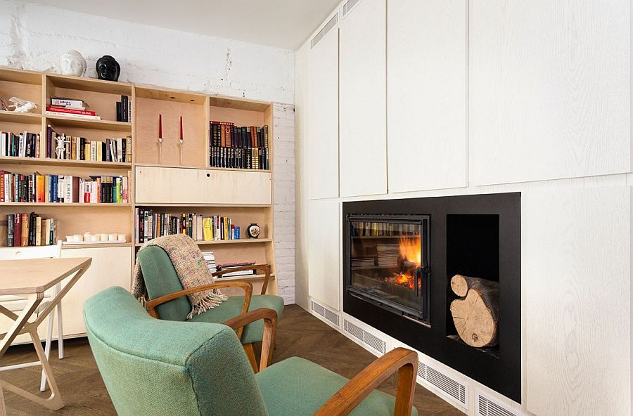 Cabinet around the fireplace provide additional storgae space