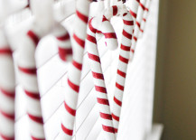 Candy-canes-and-pinecones-hung-in-a-window-217x155