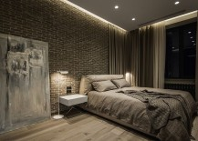 Casual-placement-of-giant-wall-art-piece-adds-to-the-dark-demeanor-of-the-posh-bedroom-217x155