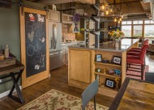 Chalkboard door and barn door track create a dynamic message board in the kitchen