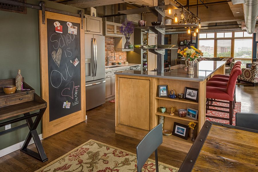 Chalkboard door and barn door track create a dynamic message board in the kitchen [Design: Silent Rivers Design+Build]