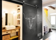 Chalkboard wall and sliding door hide the tiny bathroom on lower level 217x155 Tasteful Fusion: Vivacious Remodeling of 1880s Montreal Row House