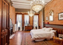 Chandeliers-and-brick-walls-give-the-bedroom-a-classy-appeal-217x155