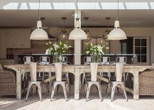 Charming dining room with industrial lighting and a cool indoor-outdoor interplay [Design: Randell Design Group]