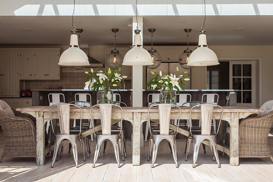 Charming Dining Room With Industrial Lighting And A Cool