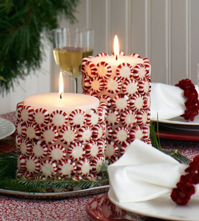 Christmas candies glued to white pillar candles