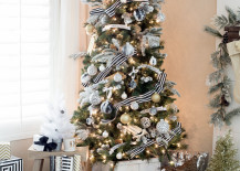 Christmas tree with gold ornaments plus black and white striped ribbon 217x155 20 Chic Holiday Decorating Ideas with a Black, Gold, and White Color Scheme