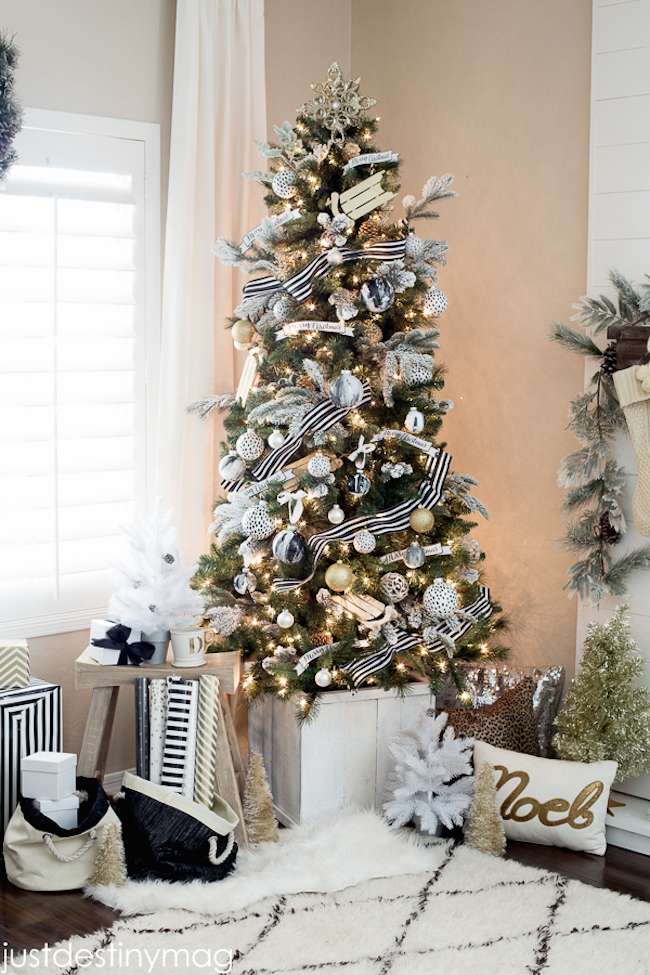 view in gallery christmas tree with gold ornaments plus black and white striped ribbon