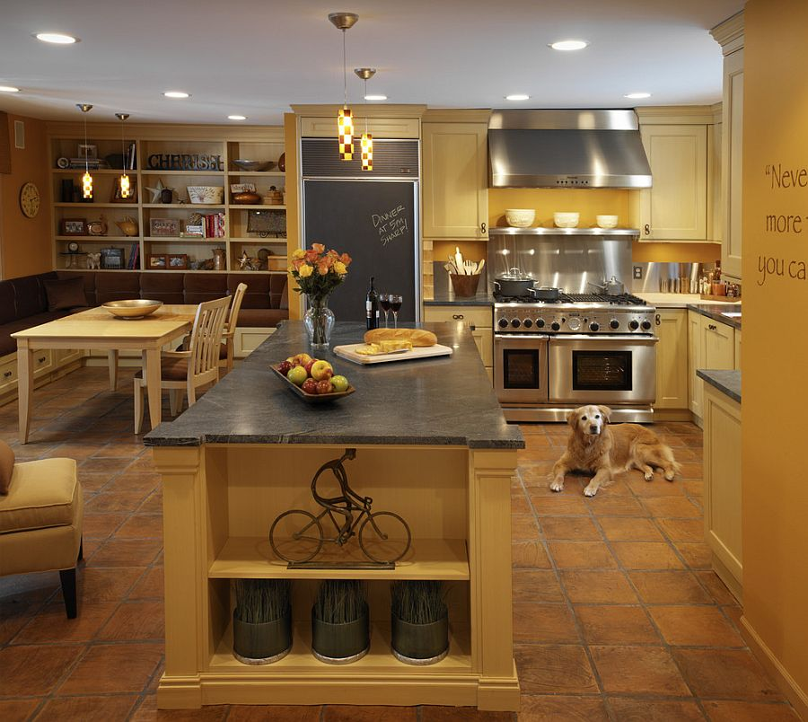 Classic Mediterranean style kitchen with warm yellows and terracotta floor tiles