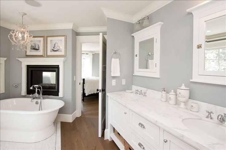 Clean and tranquil bathroom with dual fireplace