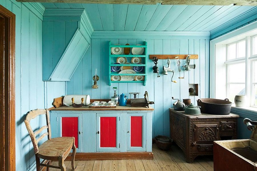 Clever use of blue in the kitchen gives it a cheerful and visually spacious look [From: Michael Kelley Photography]