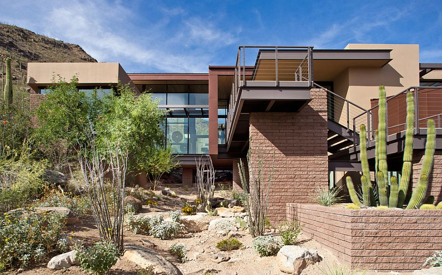 Color and finish of the contemporary home lets it blend with the rugged landscape around it