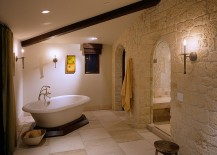 Color and texture of the stone give the bathroom a Mediterranean vibe