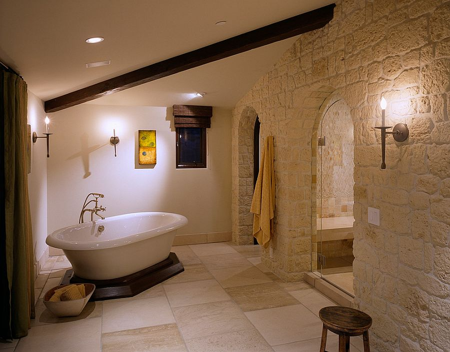 Color and texture of the stone give the bathroom a Mediterranean vibe [Design: Gordon Gibson Construction]