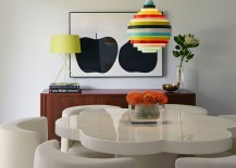 Colorful accent lighting in midcentury dining room